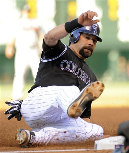 Colorado Rockies' Todd Helton slides safe into third during the first inning of a baseball game against the Atlanta Braves, Friday, May 4, 2012, in Denver. (AP Photo/Jack Dempsey)