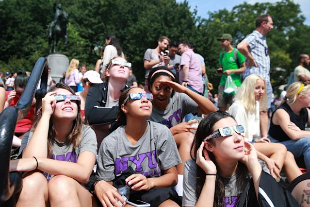 <p>Members of the NYU women's volleyball team take a break from school to see the total solar eclipse in Union Square, New York City, on Aug. 21, 2017. (Gordon Donovan/Yahoo News) </p>