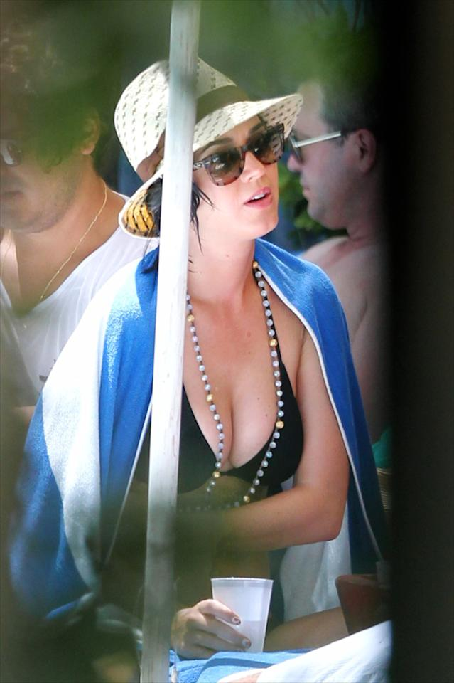 """After a dip in the pool, the pop star chatted with pals and sipped ice water. Meanwhile, her ex was busy being sentenced to <a target=""""_blank"""" href=""""http://omg.yahoo.com/photos/community-service-slideshow/"""">community service</a> in New Orleans over his now-infamous iPhone throwing incident. (7/27/2012)"""