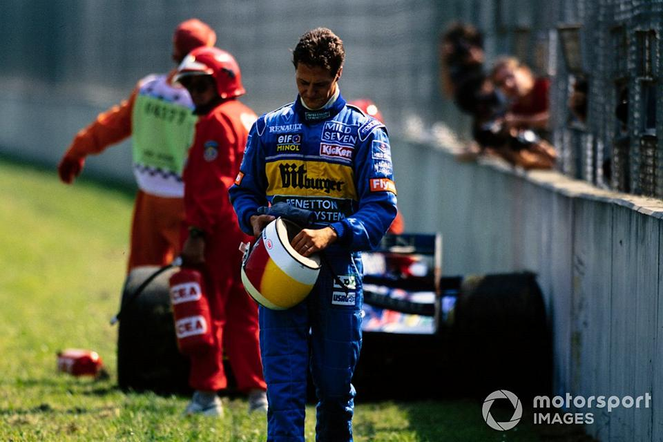 """Michael Schumacher, Benetton B195 Renault walks back to the pits after retirement<span class=""""copyright"""">Motorsport Images</span>"""