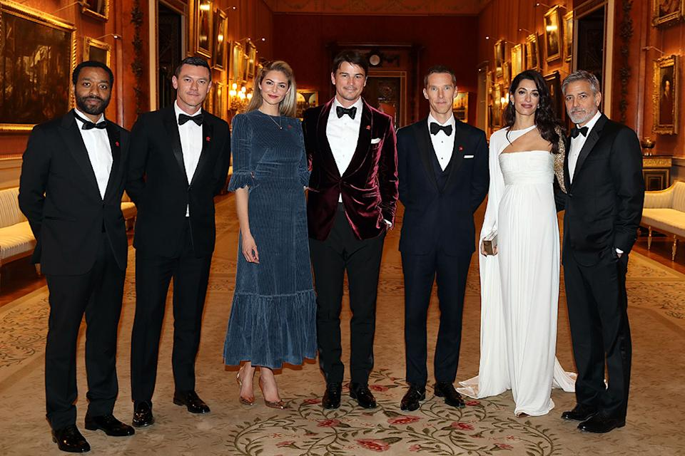 A handsome group of people post for a photo at The Price's Trust dinner.