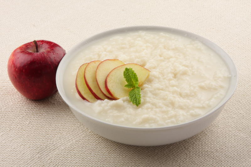 Homemade rice pudding with milk and apples.