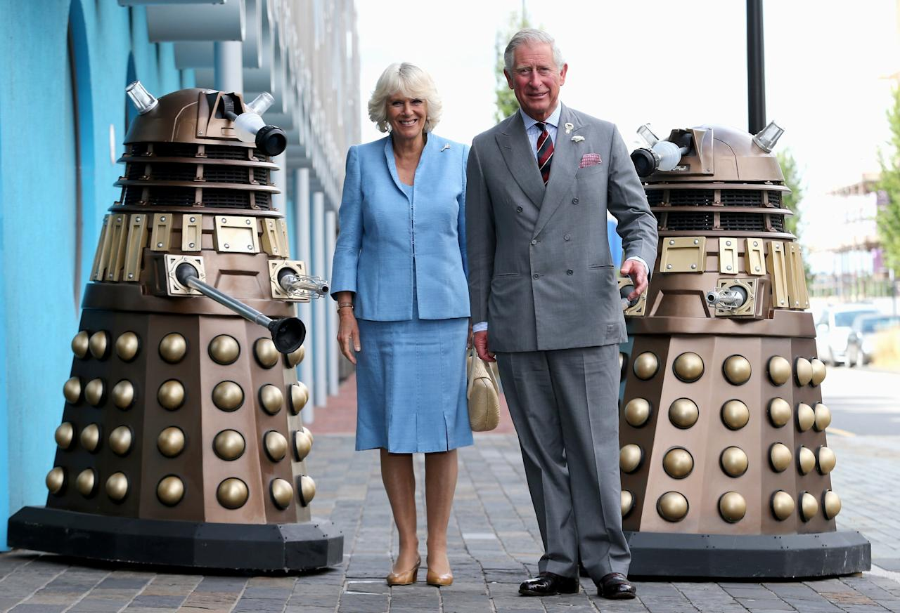 CARDIFF, WALES - JULY 03: Prince Charles, Prince of Wales and Camilla, Duchess of Cornwall pose next to two Daleks as they visit BBC Roath Lock Studios on July 3, 2013 in Cardiff, Wales. (Photo by Chris Jackson/Getty Images)