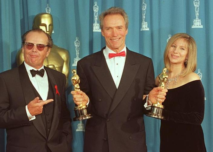 """Clint Eastwood (C) won two Oscars in 1993 for """"Unforgiven"""" for best picture and best director -- he is seen with presenters Jack Nicholson and Barbra Streisand (AFP Photo/SCOTT FLYNN)"""