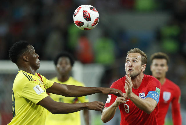 <p>Colombia's Davinson Sanchez, left, and England's Harry Kane challenge for the ball during the round of 16 match between Colombia and England at the 2018 soccer World Cup in the Spartak Stadium, in Moscow, Russia, Tuesday, July 3, 2018. (AP Photo/Alastair Grant) </p>
