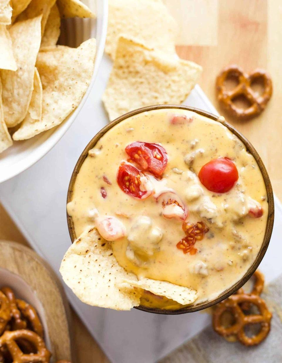 """<p>If you love a good juicy burger, you'll go crazy for this dip. Tip: You can brown the ground beef and onions in the slow cooker on the sauté function. </p><p><strong>Get the recipe at <a href=""""https://deliciousmadeeasy.com/2018/01/slow-cooker-cheeseburger-dip/"""" rel=""""nofollow noopener"""" target=""""_blank"""" data-ylk=""""slk:Delicious Made Easy"""" class=""""link rapid-noclick-resp"""">Delicious Made Easy</a>. </strong></p><p><strong><a class=""""link rapid-noclick-resp"""" href=""""https://go.redirectingat.com?id=74968X1596630&url=https%3A%2F%2Fwww.walmart.com%2Fsearch%2F%3Fquery%3Dpioneer%2Bwoman%2Bbowl&sref=https%3A%2F%2Fwww.thepioneerwoman.com%2Ffood-cooking%2Fmeals-menus%2Fg37397047%2Fslow-cooker-dips%2F"""" rel=""""nofollow noopener"""" target=""""_blank"""" data-ylk=""""slk:SHOP BOWLS"""">SHOP BOWLS</a><br></strong></p>"""