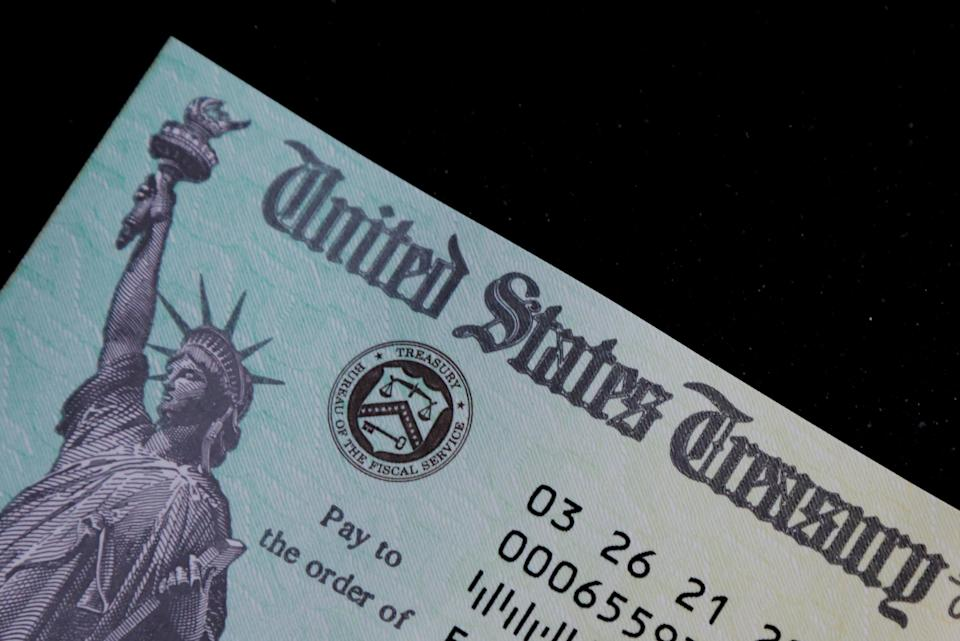 FILE PHOTO: A family's stimulus check from the U.S. Treasury for the coronavirus disease (COVID-19) aid. The federal debt ceiling has been raised over 100 times.