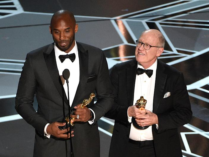 "Kobe Bryant (left) and Glen Keane accept the award for best animated short for ""Dear Basketball"" at the Oscars on Sunday, March 4, 2018."