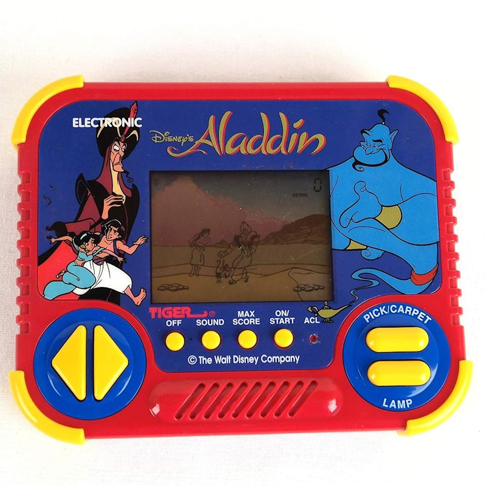 <p>Santa, if you're listening, we need this <span>Aladdin Tiger Handheld Game</span> ($53) ASAP. </p>