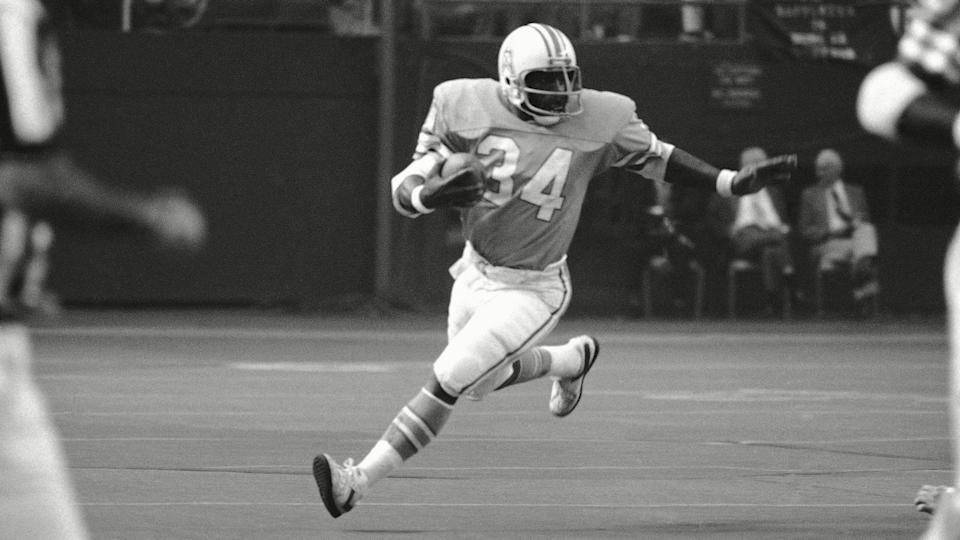 Mandatory Credit: Photo by Ed Kolenovsky/AP/Shutterstock (6031629a)Earl Campbell, Shane Nelson Houston Oilers? running back, Earl Campbell (34) rambles around his right end after taking a pitchout to pick up three yards in the second quarter of the NFL game at Houston, .