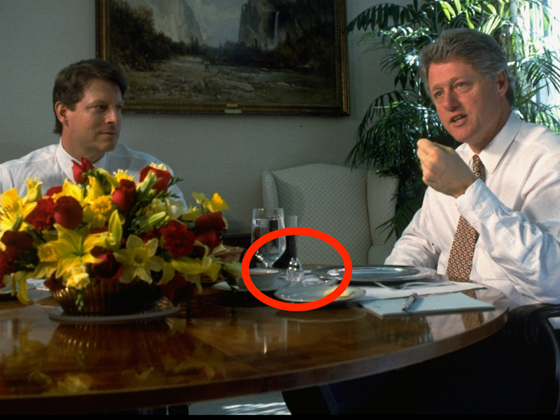 Pres. Bill Clinton answering reporter's query while having lunch w. VP Al Gore (L) at WH.