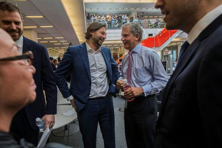 Photojournalist Daniel Berehulak (C), with Arthur Ochs Sulzberger Jr., the publisher of The New York Times (2nd R), celebrate the announcement of the 2017 Pulitzer Prizes, in New York, U.S., April 10, 2017.  Hiroko Masuike/Courtesy The New York Times/Handout via REUTERS