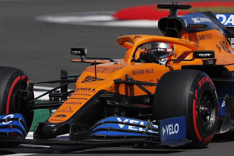 <p>McLaren's Spanish driver Carlos Sainz Jr steers his car during the qualifying session for the Formula One British Grand Prix at the Silverstone motor racing circuit in Silverstone, central England on August 1, 2020.</p>