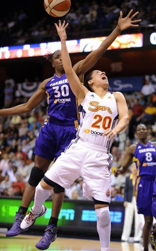 Connecticut Sun's Kara Lawson, right, is fouled by Los Angeles Sparks' Nneka Ogwumike during the first half of a WNBA basketball game in Uncasville, Conn., Wednesday, June 13, 2012. (AP Photo/Fred Beckham)