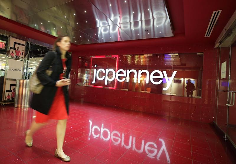 FILE - In this April 9, 2013 file photo, a customer leaves a J.C. Penney store in New York. J.C. Penney Co. is expected to report quarterly results on Thursday, May 16, 2013.  (AP Photo/Mark Lennihan)