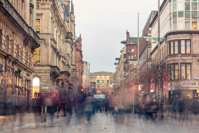 Glasgow / Scotland - February 15, 2019: a blur of shoppers and commuters during the evening rush hour on Buchanan street in the city centre