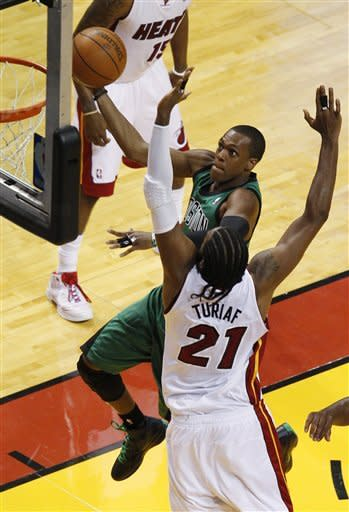 Boston Celtics' Rajon Rondo (9) shoots over Miami Heat's Ronny Turiaf (21) during the first half of Game 1 in their NBA basketball Eastern Conference finals playoffs series, Monday, May, 28, 2012, in Miami. (AP Photo/Wilfredo Lee)