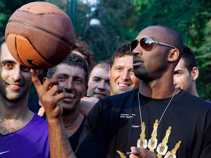 Bryant plays with a ball during a sponsor's event in Milan during 2011: AP