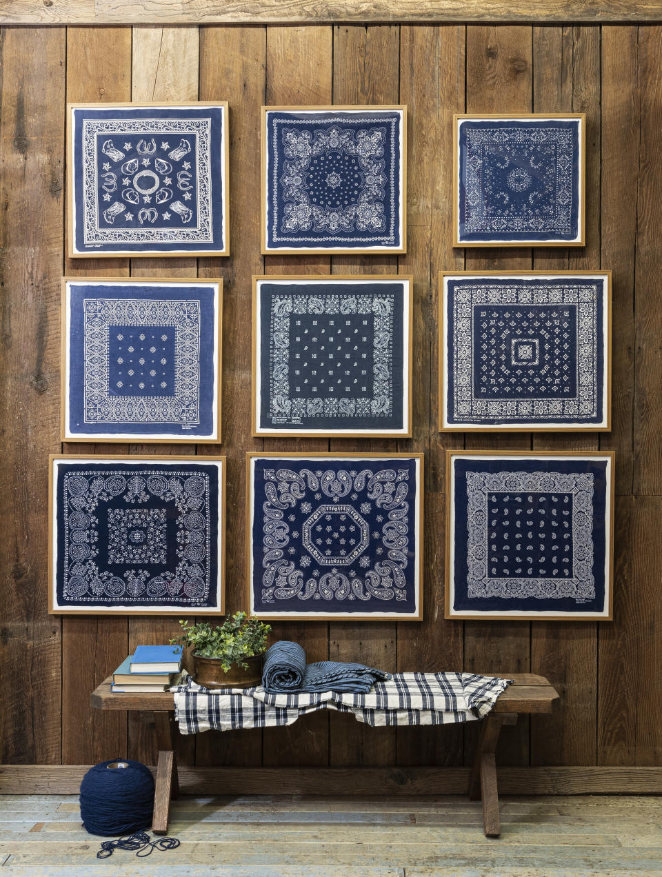 This image released by Portland Oregon-based interior designer Max Humphrey shows framed bandanas that serve as decorative wall art. (Christopher Dibble via AP)
