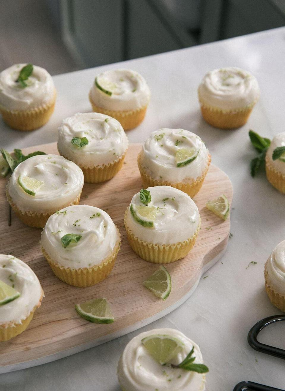 """<p>A cold mojito hits the spot on a hot day—and so do these mojito cupcakes! They're infused with lime juice, fresh mint, and a little rum, of course.</p><p><strong>Get the recipe at <a href=""""https://www.acozykitchen.com/mojito-cupcakes"""" rel=""""nofollow noopener"""" target=""""_blank"""" data-ylk=""""slk:A Cozy Kitchen"""" class=""""link rapid-noclick-resp"""">A Cozy Kitchen</a>.</strong><br><br><a class=""""link rapid-noclick-resp"""" href=""""https://go.redirectingat.com?id=74968X1596630&url=https%3A%2F%2Fwww.walmart.com%2Fsearch%2F%3Fquery%3Dpioneer%2Bwoman%2Bcutting%2Bboards&sref=https%3A%2F%2Fwww.thepioneerwoman.com%2Ffood-cooking%2Frecipes%2Fg36343624%2F4th-of-july-cupcakes%2F"""" rel=""""nofollow noopener"""" target=""""_blank"""" data-ylk=""""slk:SHOP PIONEER WOMAN CUTTING BOARDS"""">SHOP PIONEER WOMAN CUTTING BOARDS</a></p>"""