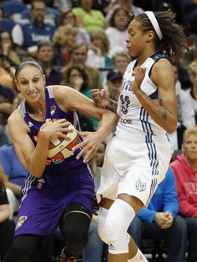 Phoenix Mercury guard Diana Taurasi (3) protects the ball from Minnesota Lynx guard Seimone Augustus (33) in the second half of a WNBA basketball game, Thursday, June 6, 2013, in Minneapolis. The Lynx won 99-79. (AP Photo/Stacy Bengs)