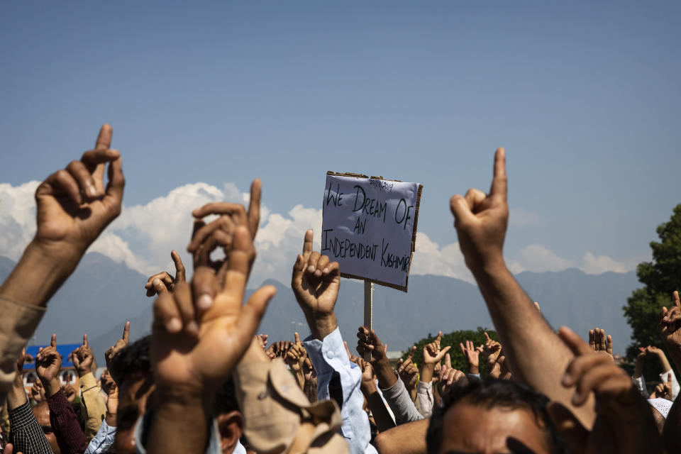 Kashmiri men shout freedom slogans during a protest against New Delhi's tightened grip on the disputed region, after Friday prayers on the outskirts of Srinagar, Indian controlled Kashmir, Aug. 23, 2019. The image was part of a series of photographs by Associated Press photographers which won the 2020 Pulitzer Prize for Feature Photography. (AP Photo/Dar Yasin)