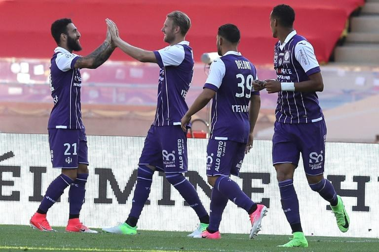 "Toulouse's Ola Toivonen (2nd R) celebrates after scoring a goal against Monaco on April 29, 2017 at the ""Louis II Stadium"" in Monaco"