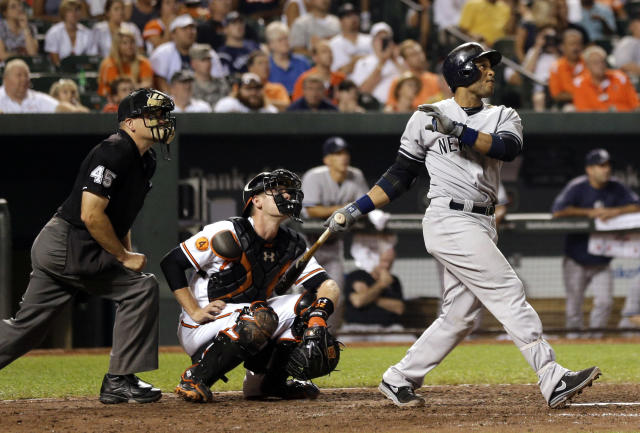 New York Yankees' Robinson Cano watches his solo home run in the ninth inning of a baseball game against the Baltimore Orioles, Wednesday, Sept. 11, 2013, in Baltimore. New York won 5-4. (AP Photo/Patrick Semansky)