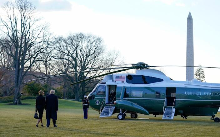 President Donald Trump and first lady Melania Trump walk to board Marine One on the South Lawn of the White House - Alex Brandon/AP