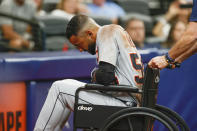 Detroit Tigers' Derek Hill is wheeled off the field during the fifth inning of a baseball game against the Tampa Bay Rays Saturday, Sept. 18, 2021, in St. Petersburg, Fla. (AP Photo/Scott Audette)