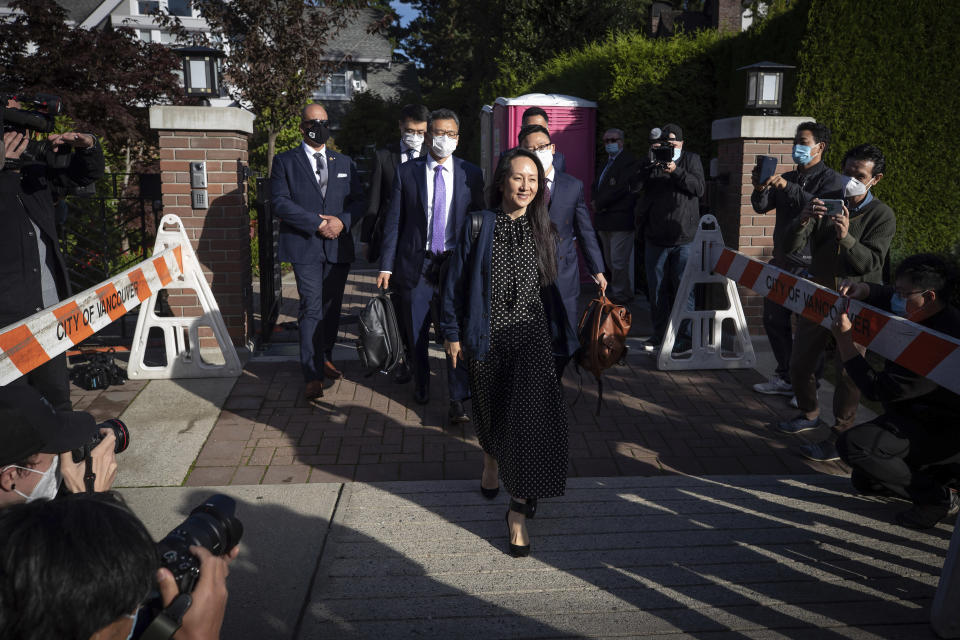 Meng Wanzhou, chief financial officer of Huawei Technologies, leaves her home in Vancouver, on Friday, Sept. 24, 2021. Wanzhou has resolved criminal charges against her as part of a deal with the U.S. Justice Department that could pave the way for her to return to China and that concludes a case that roiled relations between Washington and Beijing. (Darryl Dyck/The Canadian Press via AP)