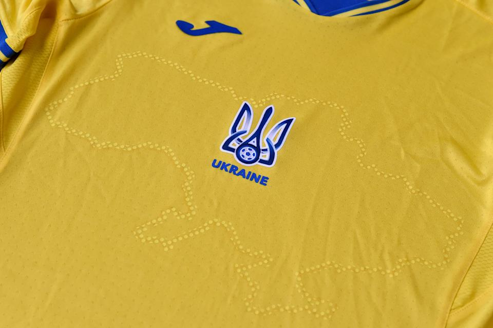 A picture taken on June 6, 2021 shows a EURO 2020 jersey of the Ukrainian national football team. - Ukraine provoked Moscow's ire on June 6, 2021 as its football federation unveiled Euro 2020 uniforms that feature Russian-annexed Crimea and nationalist slogans. The uniforms in the blue-and-yellow colours of the Ukrainian flag feature the silhouette of Ukraine that includes Russia-annexed Crimea and the separatist-controlled regions of Donetsk and Lugansk as well as the words