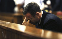 Olympic and Paralympic track star Oscar Pistorius reacts as Judge Thokozile Masipa (unseen) delivers her verdict at the North Gauteng High Court in Pretoria September 12, 2014. Pistorius was convicted of culpable homicide on Friday, escaping the more serious charge of murder for the killing of his girlfriend, Reeva Steenkamp, and will now battle to avoid going to prison. REUTERS/Alon Skuy/Pool (SOUTH AFRICA - Tags: SPORT ATHLETICS ENTERTAINMENT CRIME LAW TPX IMAGES OF THE DAY)