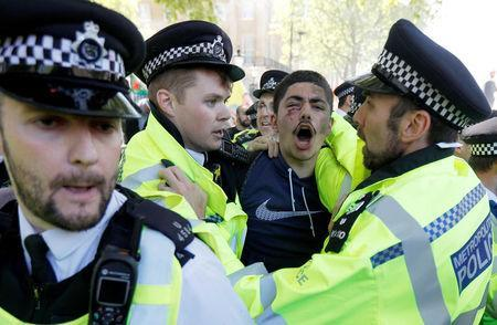 Police officers and demonstrators clash outside Downing Street ahead of the visit by Turkey's President Recep Tayyip Erdogan, in London, Britain, May 15, 2018. REUTERS/Peter Nicholls