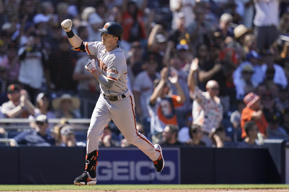 San Francisco Giants' Mike Yastrzemski, reacts after hitting a two-run home run during the second inning of a baseball game against the San Diego Padres, Thursday, Sept. 23, 2021, in San Diego. (AP Photo/Gregory Bull)