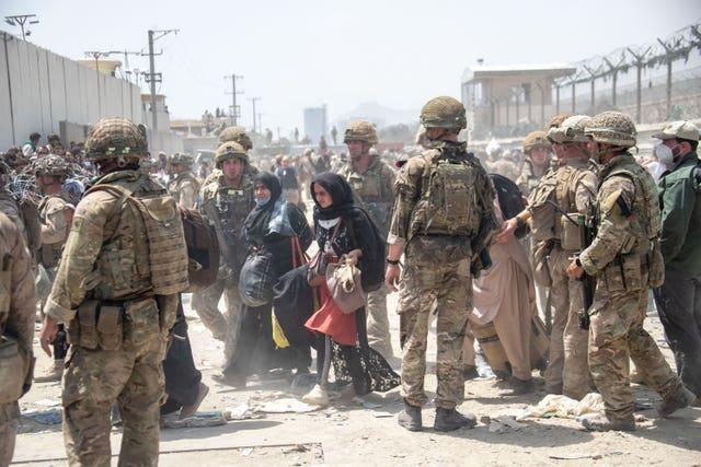 Members of the British and US military are engaged in the evacuation of people from the Afghan capital Kabul