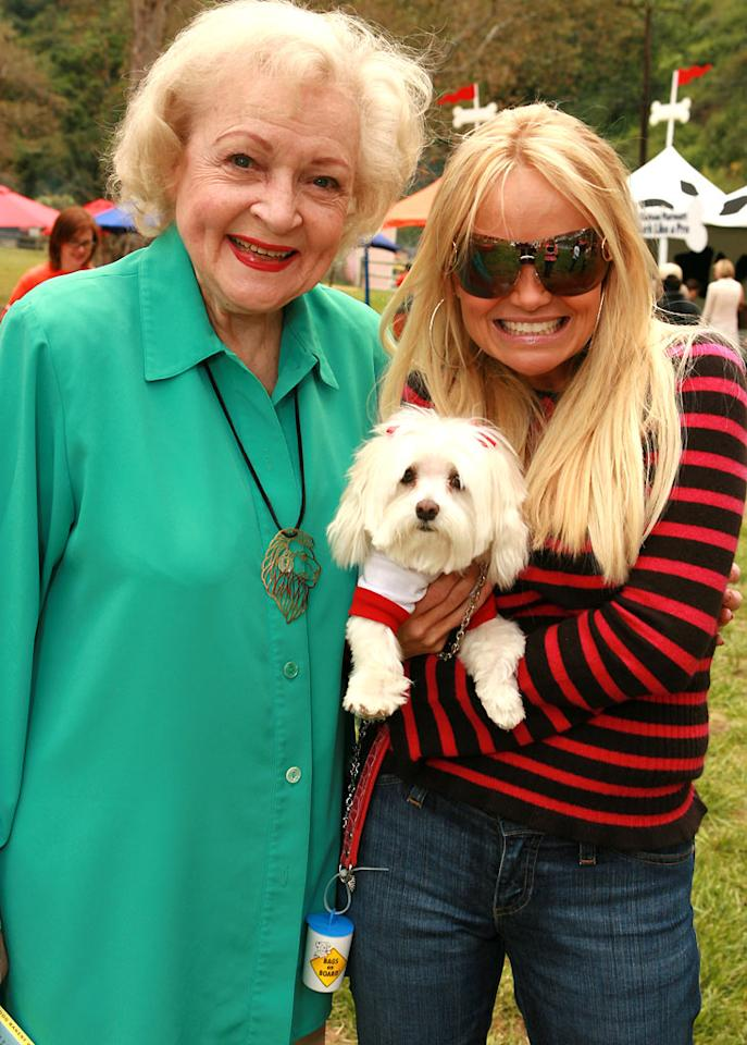 "Betty White poses with Kristen Chenoweth and her dog Maddie. Eric Charbonneau/<a href=""http://www.wireimage.com"" target=""new"">WireImage.com</a> - April 29, 2006"