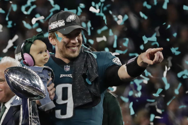 <p>Philadelphia Eagles quarterback Nick Foles (9) holds his daughter, Lily James, after winning the NFL Super Bowl 52 football game against the New England Patriots, Sunday, Feb. 4, 2018, in Minneapolis. The Eagles won 41-33. (AP Photo/Frank Franklin II) </p>