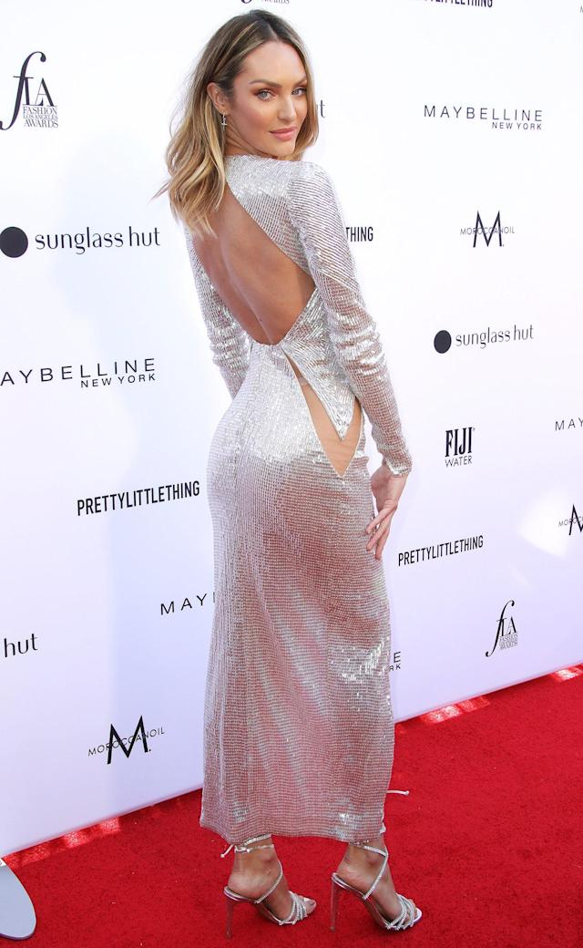 7731708191da in a plunging Julien Macdonald metallic dress with cutouts and a high slit  paired with sparkly