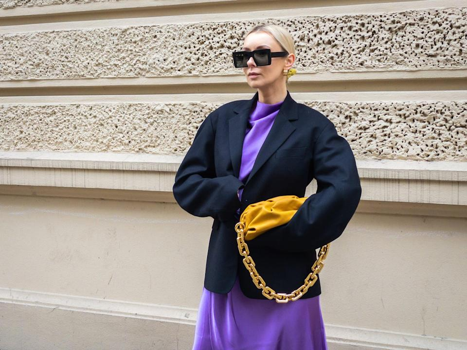 <p>Colorblocking works when the rest of your look is simple. This outfit gets a fresh spin with a bright yellow bag.</p>