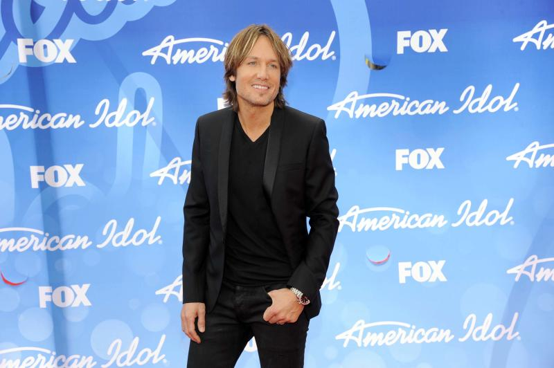 "FILE - This May 16, 2013 file photo shows Keith Urban at the ""American Idol"" finale in Los Angeles. Urban will return as a judge on the singing competition series. (Photo by Chris Pizzello/Invision/AP, File)"