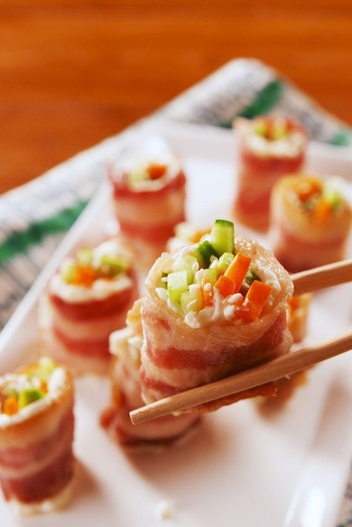 """<p>Being on a keto diet means you have way fewer options for snacking. Never fear! These little guys will satisfy all your snack cravings: They're salty, creamy, and crunchy, but they won't weigh you down. We went for carrots, cucumbers, and avocado for our filling, but the options are endless.</p><p>Get the <a href=""""https://www.delish.com/uk/cooking/recipes/a31327674/keto-bacon-sushi-recipe/"""" rel=""""nofollow noopener"""" target=""""_blank"""" data-ylk=""""slk:Keto Bacon Sushi"""" class=""""link rapid-noclick-resp"""">Keto Bacon Sushi</a> recipe.</p>"""
