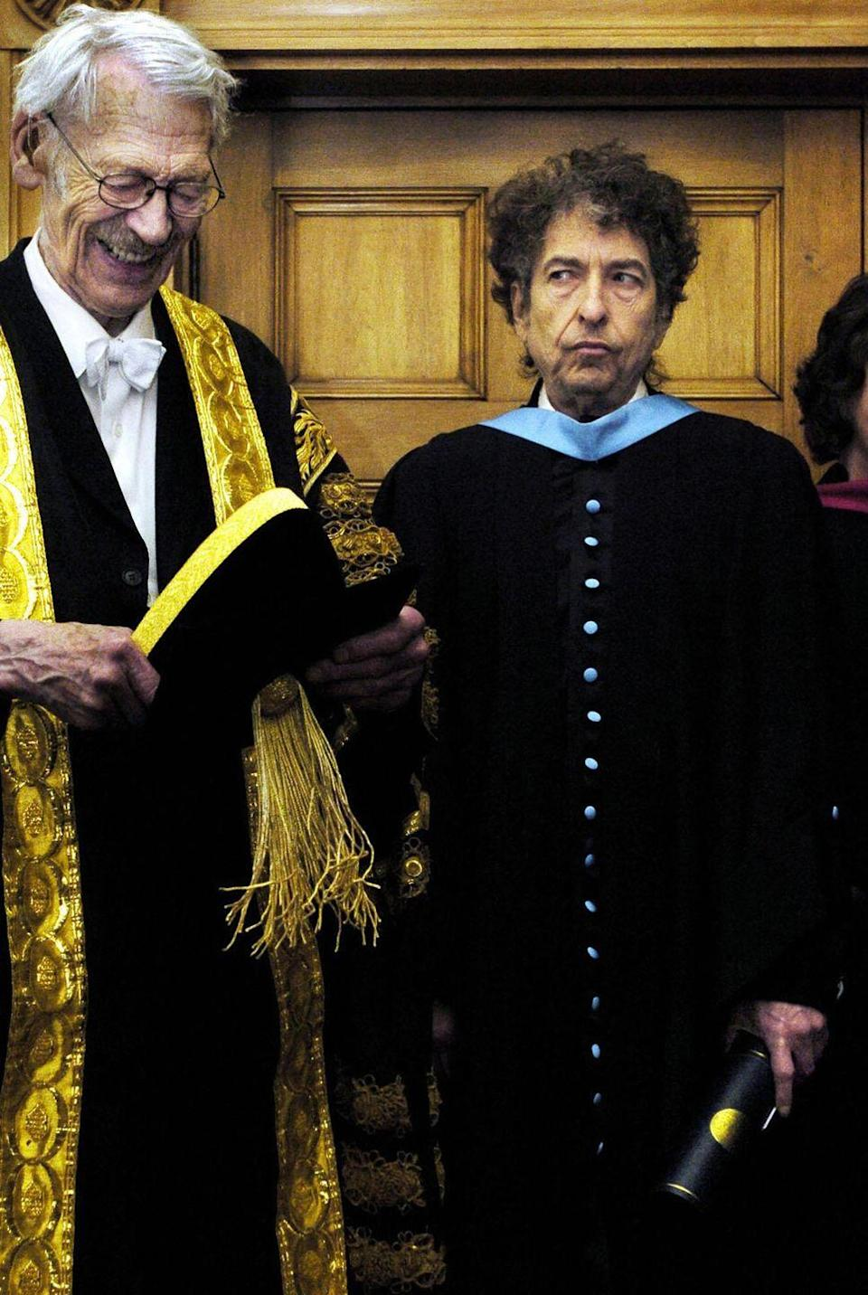 <p>Bob Dylan poses at the University of St. Andrews on June 23, 2004, after he received an honorary degree of Doctor of Music from Sir Kenneth Dover, Chancellor of the university.</p>