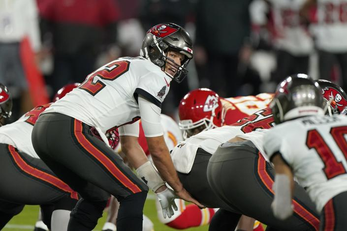 Tampa Bay Buccaneers quarterback Tom Brady takes a snap during the first half of the NFL Super Bowl 55 football game against the Kansas City Chiefs Sunday, Feb. 7, 2021, in Tampa, Fla. (AP Photo/Gregory Bull)