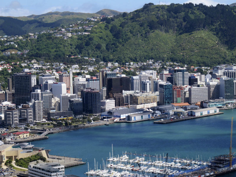 """In this Oct. 26, 2012 photo, the waterfront and city are seen from the vantage point on top of Mount Victoria, Wellington, New Zealand. Whether you're a fan making a pilgrimage to the city where the """"The Lord of the Rings"""" films were made, or you have no interest whatsoever in dwarfs and goblins, there's plenty to do in Wellington. For free. (AP Photo/Nick Perry)"""