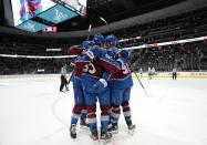 Members of the Colorado Avalanche celebrate a goal against the Los Angeles Kings during the second period of an NHL hockey game Thursday, May, 13, 2021, in Denver. (AP Photo/Jack Dempsey)