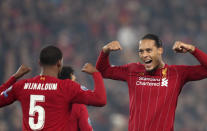 Liverpool's Georginio Wijnaldum, left, celebrates with Virgil van Dijk after scoring the opening goal during the Champions League group E soccer match between Liverpool and Genk at Anfield Stadium, Liverpool, England, Tuesday, Nov. 5, 2019. (AP Photo/Jon Super)