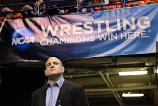 Penn State coach Cael Sanderson looks on during the NCAA Wrestling Championships. (Getty)