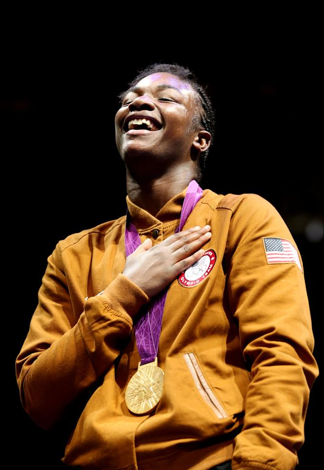 LONDON, ENGLAND - AUGUST 09: Gold medalist Claressa Shields of the United States celebrates on the podium during the medal ceremony for the Women's Middle (75kg) Boxing final bout on Day 13 of the London 2012 Olympic Games at ExCeL on August 9, 2012 in London, England.  (Photo by Scott Heavey/Getty Images)