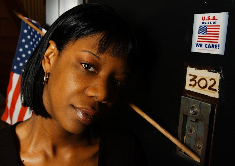 9/11 survivor Marcy Borders, seen here outside her New Jersey apartment in 2002, struggled with depression and drug and alcohol abuse for years after the attacks (AFP Photo/Stan Honda)